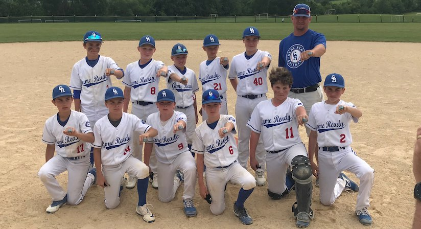 Oasis sponsored youth baseball team with their rings held out