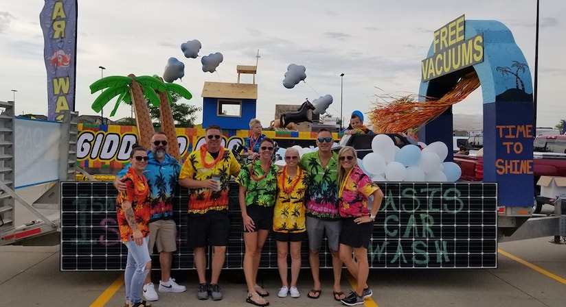 Oasis owner & family in front of Summerfest float