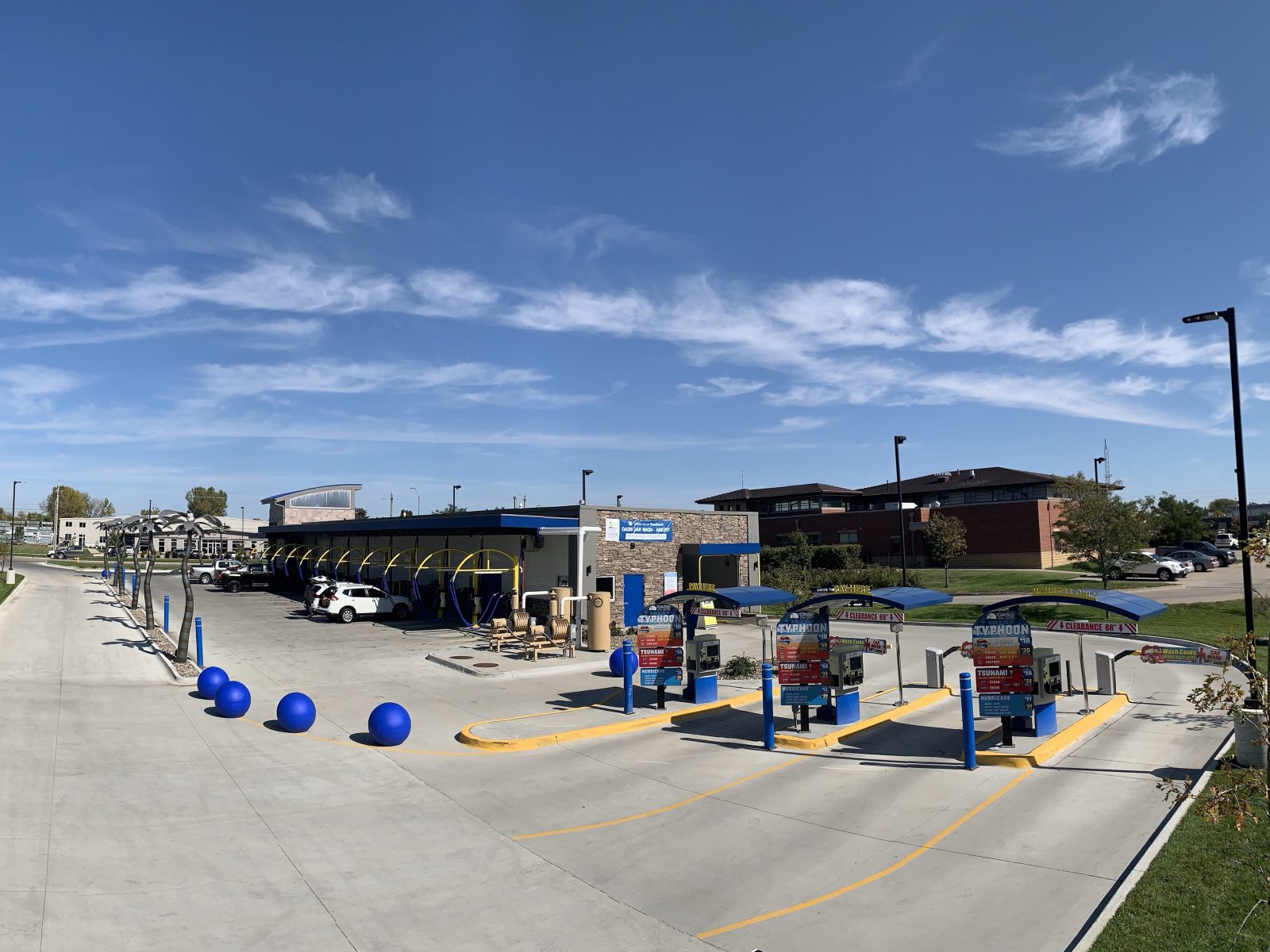 Oasis car wash on a beautiful day with cars ready to be washed